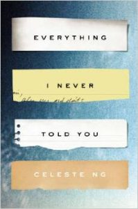 Book cover for Everything I Never Told You by Celeste Ng that shows four torn strips of paper with text on them