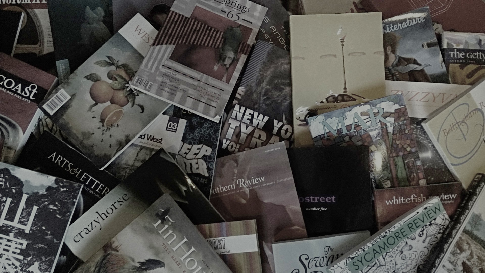 Scattered pile of different literary journals