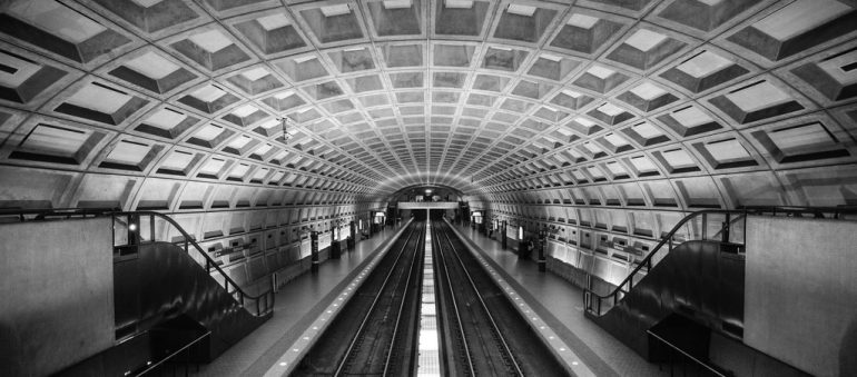 Black and white photo of an empty subway stop