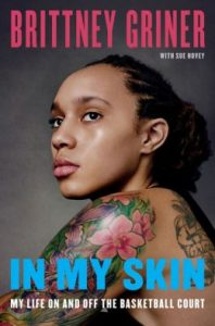 Book cover with a portrait of a Black woman with a large floral shoulder tattoo and tattoos on her back