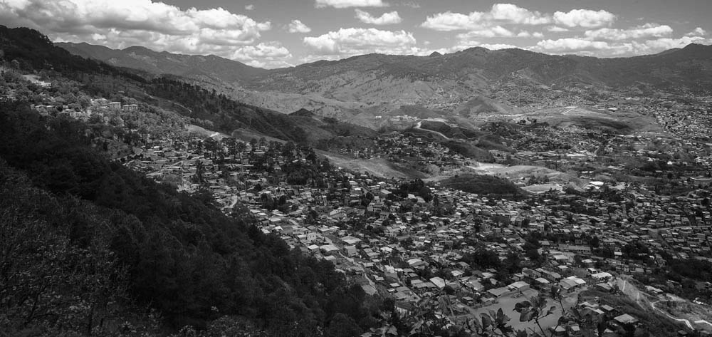 Black and white photo of a town on the side of a mountain