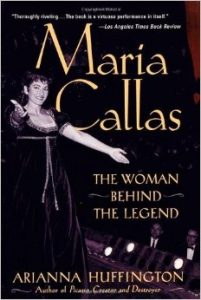 book cover shows a woman wearing a velvet dress standing on a stage with her arms open