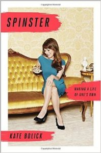 book cover shows a woman sitting with her legs crossed on a yellow velvet couch