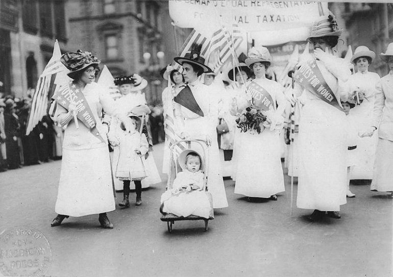 photo of women marching for the right to vote